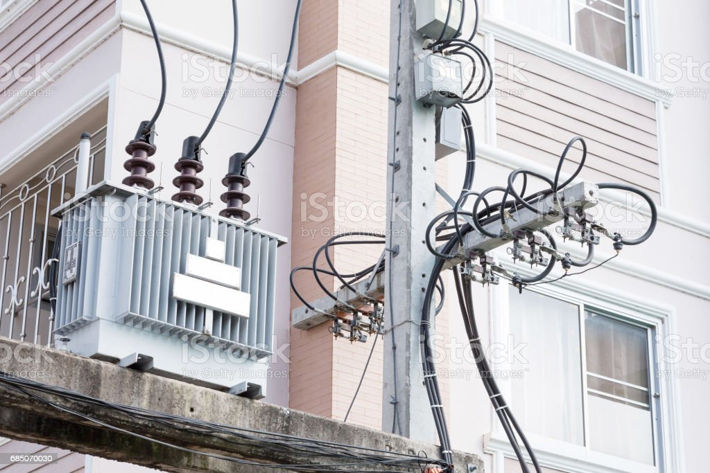 High Voltage Electrical Transformer High On Concrete Poles Near ...