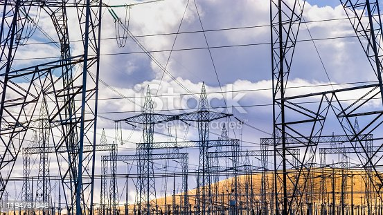 istock High voltage electricity towers and power lines at a substation in Central California; a substation is a part of an electrical generation, transmission, and distribution system 1194767846