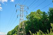 High voltage line, electricity pylon, sunlight, forest