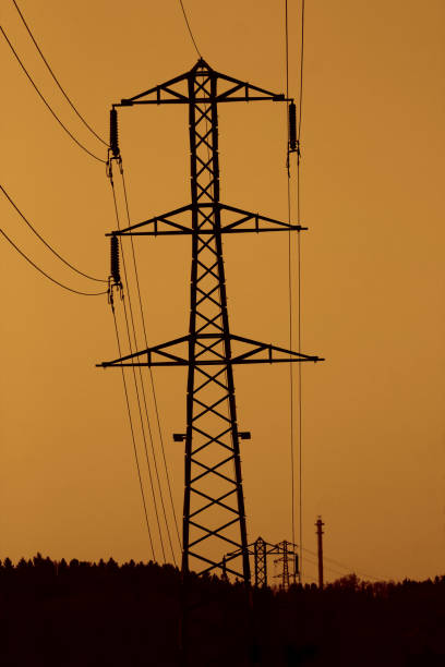 High voltage line in the sunset stock photo