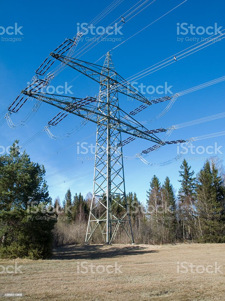 High voltage mast on a forest Glade stock photo