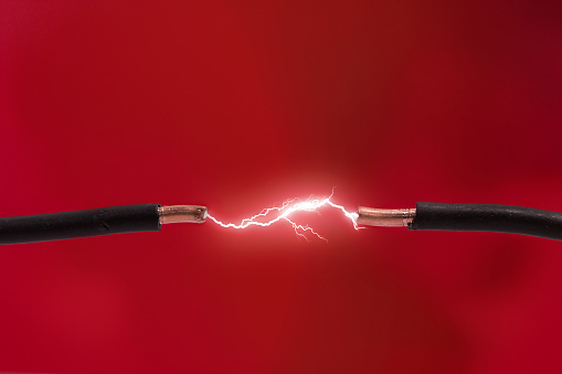 Electrical spark between two wires.