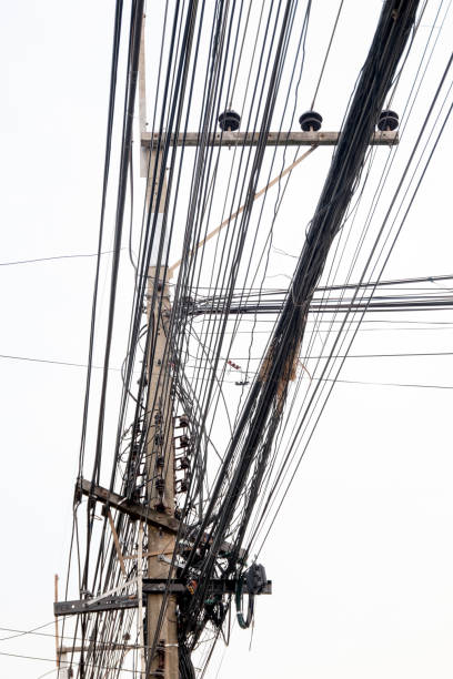 high voltage pole on sky sunset background. stock photo