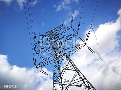 High voltage pillar on a background of blue sky