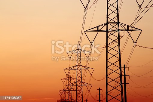 High voltage poles on the evening sky