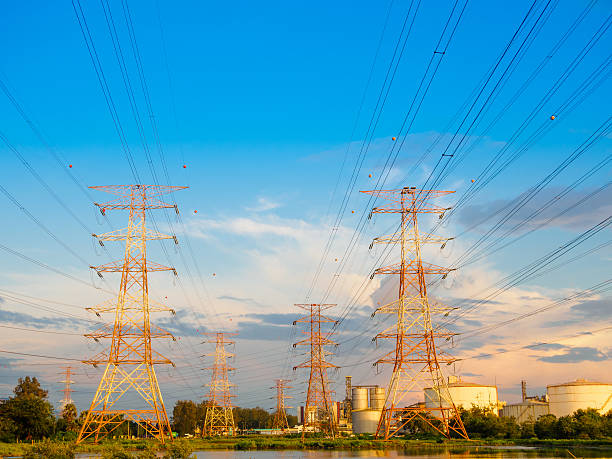 high voltage post or high voltage tower in green field - generator text stock-fotos und bilder