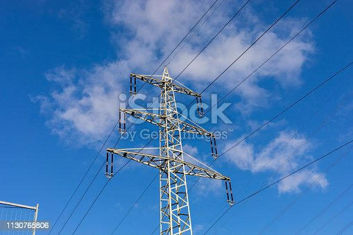 high voltage post.High-voltage tower sky background in Germany.