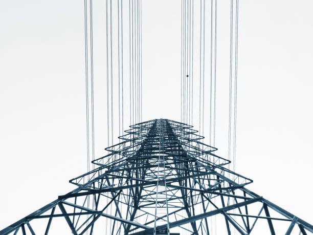 high voltage post power line high voltage tower industry - rete elettrica foto e immagini stock