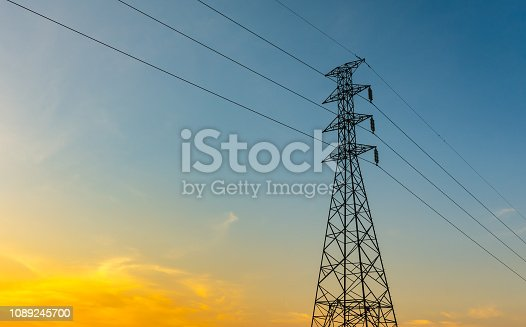 High voltage post,Electricity pylons and lines at sunset.