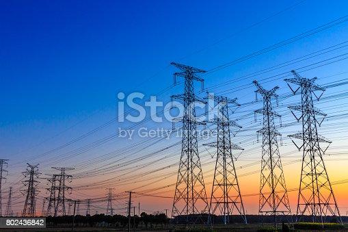 istock high voltage post,High voltage tower sky background 802436842