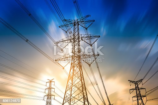 istock high voltage post.High-voltage tower sky background. 836124870