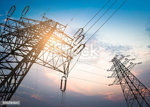 istock high voltage post.High-voltage tower sky background. 836394642