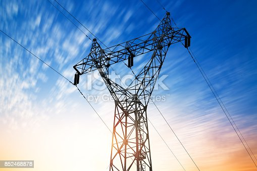 istock high voltage post.High-voltage tower sky background. 852468878