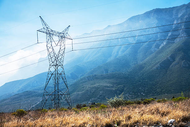 High voltage power, electrical lines with mountains. stock photo