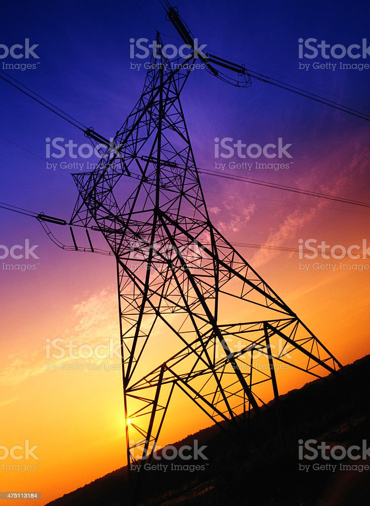 High voltage power electrical pylons with sunset. stock photo