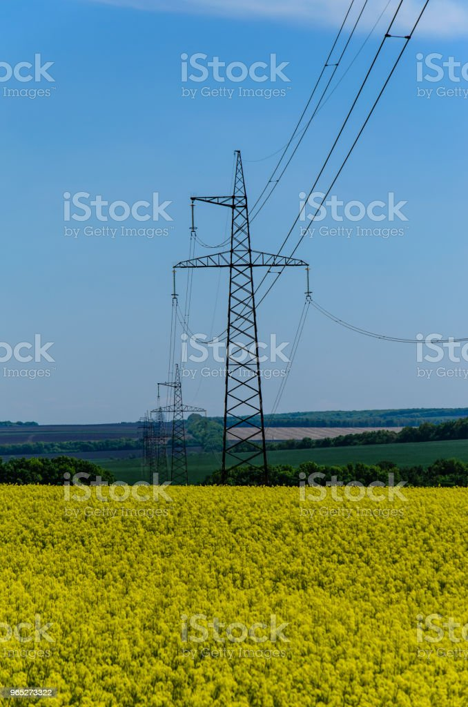 High voltage power line against sky royalty-free stock photo
