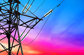 High voltage power lines at sunset, electricity distribution station. Electric power transmission