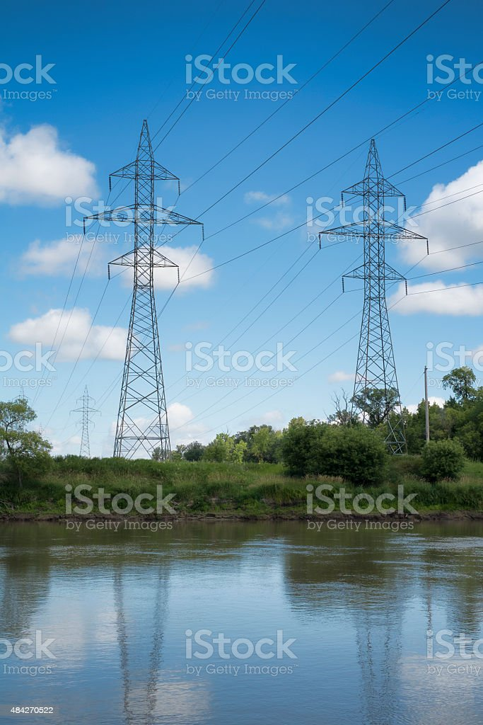High Voltage Power Lines Beside River stock photo