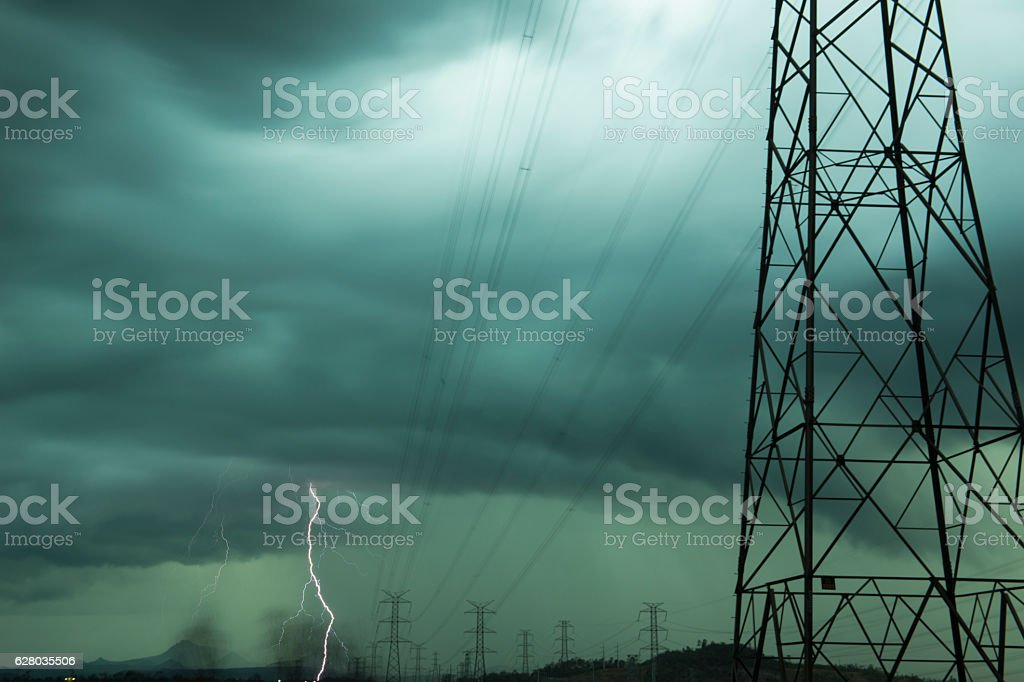 High voltage power lines during a storm stock photo