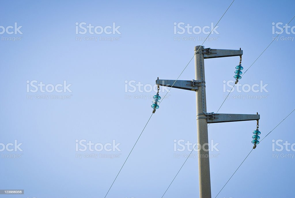 High Voltage Power Lines on a Clear Blue Sky stock photo