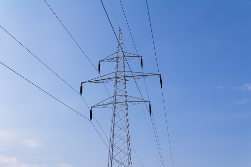 600401714 istock photo A high voltage power pylons 1034123470