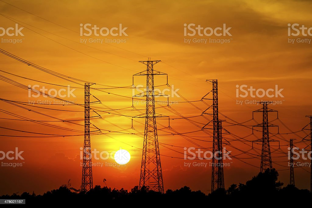 High voltage power transmission lines and pylons royalty-free stock photo