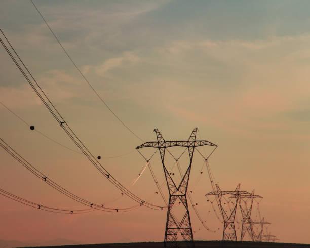 high voltage pylons stock photo