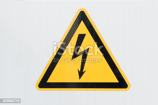 High Voltage sign close up - on gray background