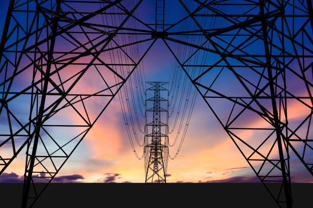 High voltage tower and Colorful sky. stock photo
