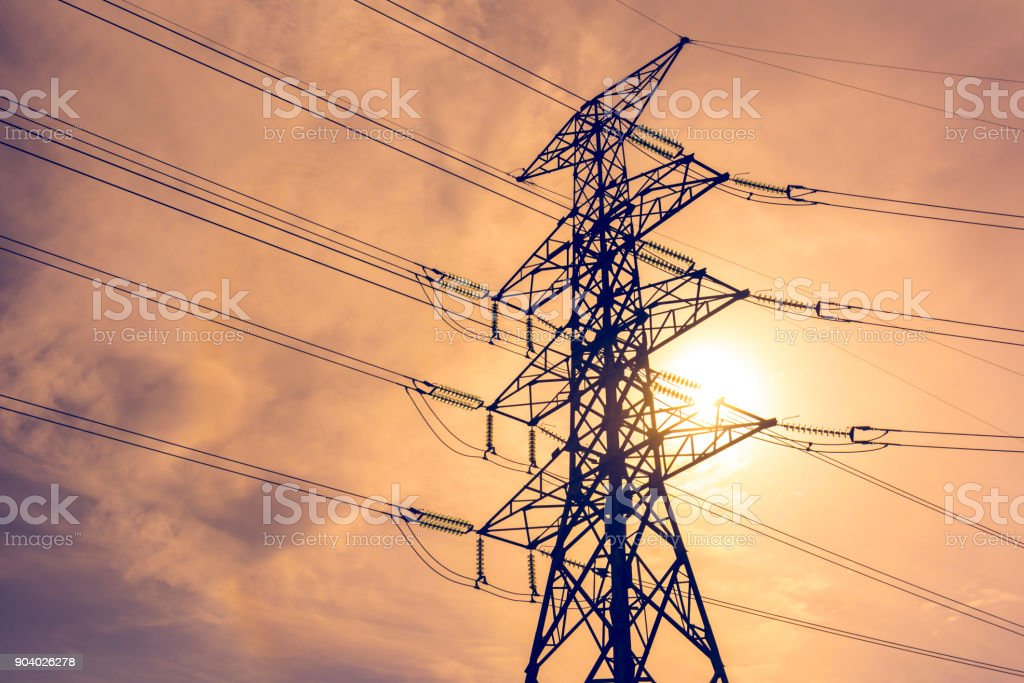 High voltage tower and the sun on the sky. stock photo