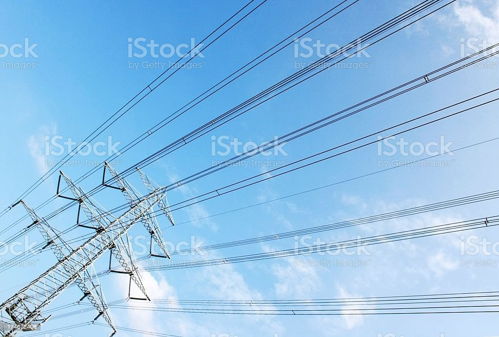 high voltage tower cable on blue sky stock photo