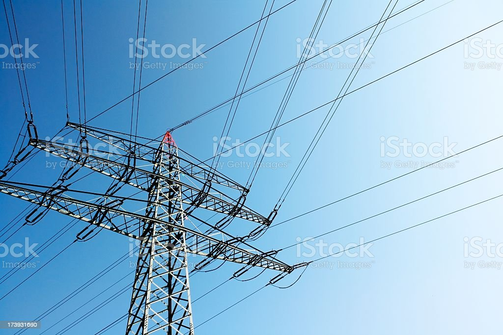 High voltage tower on blue sky stock photo