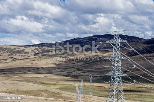 High-voltage electric wires under the blue sky