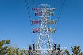 High voltage tower under blue sky