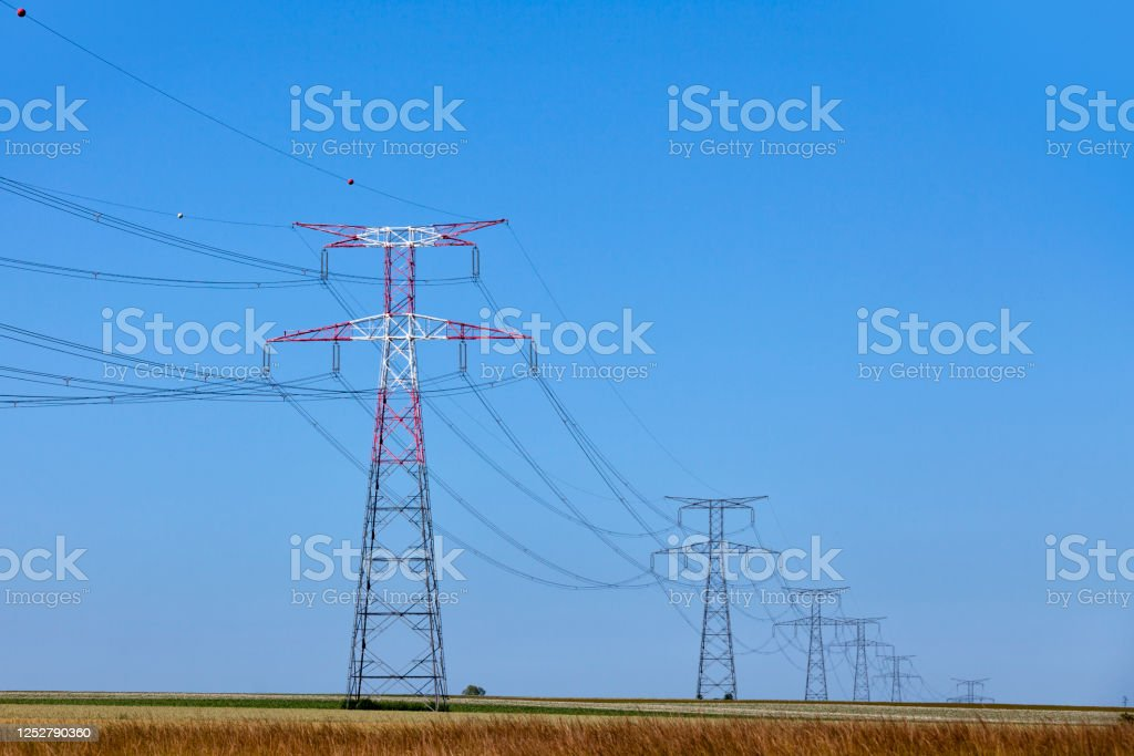 High voltage towers in a rural landscape - Royalty-free Agricultural Field Stock Photo