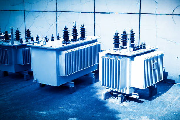 high voltage transformer with electrical insulation and electrical equipment in power substation. - capacitor stock photos and pictures