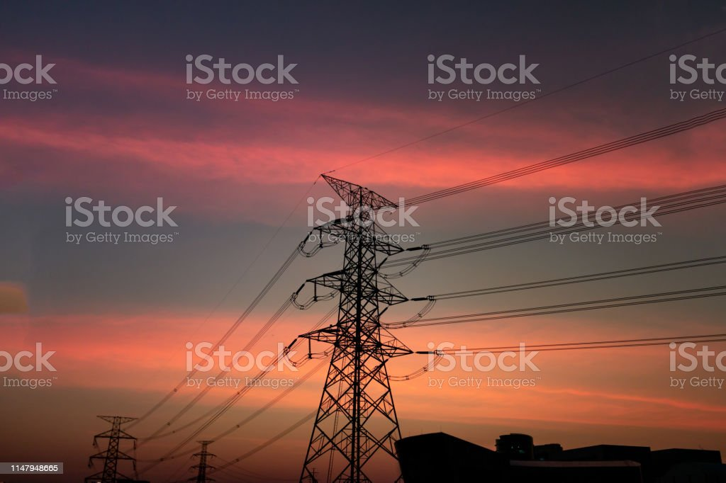 High voltage transmission lines on sunset time and sky on sunset time...