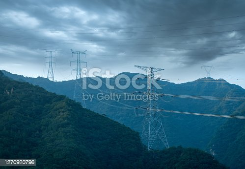 High voltage transmission tower at the mountain