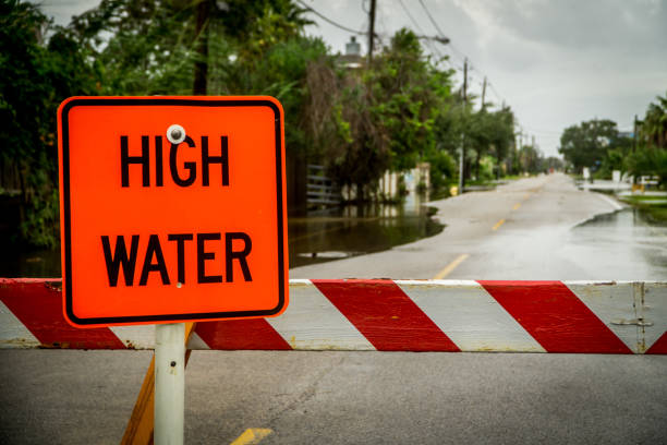 High water sign blocking a road near Houston Texas stock photo