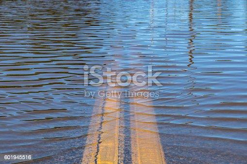 Closeup of high water flooding on neighborhood street.