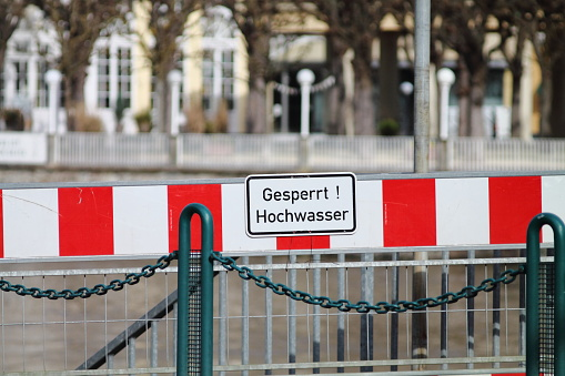 High water warning street sign on spa town Bad Ems embankment.