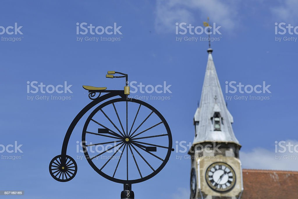High Wheeler with Church stock photo