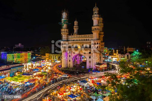 Long Exposure Shot of Traffic moving around Charminar during ramadan season on the night of eid in hyderabad, india.