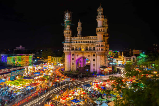 High Wide Angle View of Charminar in the Night Long Exposure Shot of Traffic moving around Charminar during ramadan season on the night of eid in hyderabad, india. char minar stock pictures, royalty-free photos & images