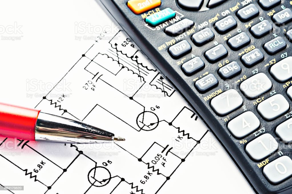 High-angle view of circuit diagram with calculator and pen royalty-free stock photo
