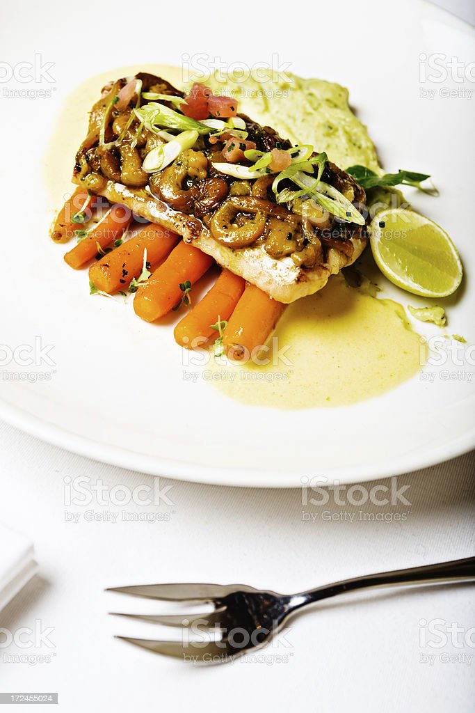 High-angle view of grilled fish, cashew nuts and vegetables royalty-free stock photo