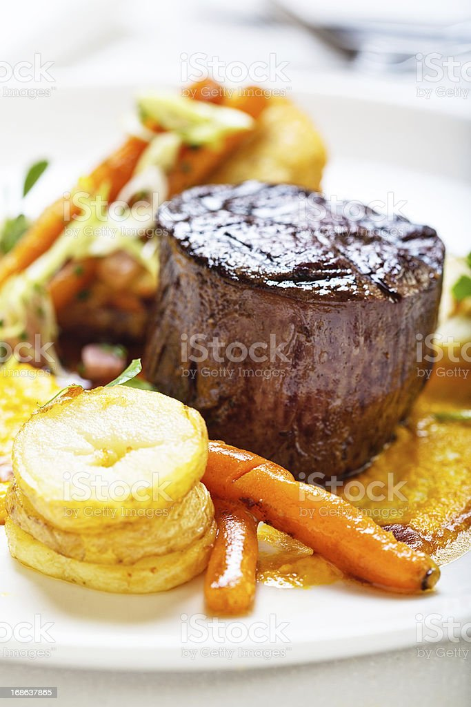 High-angle view of restaurant style steak and vegetables royalty-free stock photo