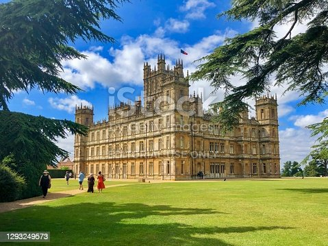 Hampshire, England, UK-July 21, 2019: Highclere Castle is a Jacobethan style country house built in the 19th century. The Carnarvon family has lived here since 1679. The estate is located in Hampshire, England. It was the place where the popular TV show Downton Abbey was taken. Downton Abbey fans can join a guided tour to see the locations where favourite characters made their the star appearances, such as Robert Crawley, Lady Mary, Lady Edith and Matthew etc.