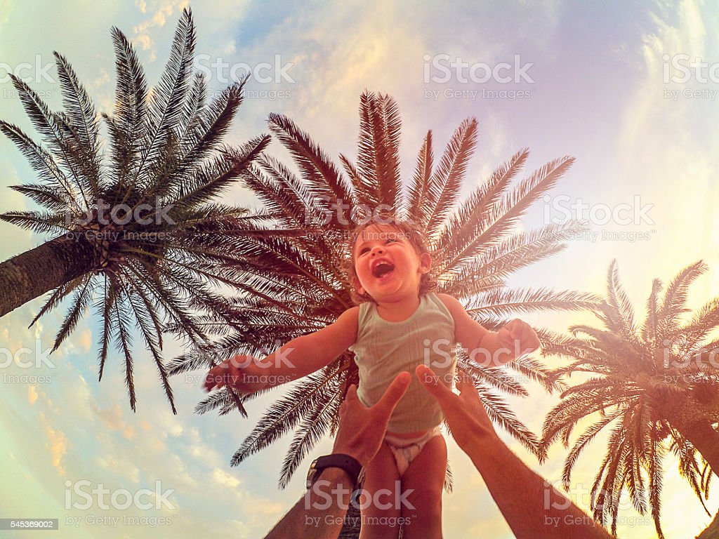 Higher daddy, higher... stock photo
