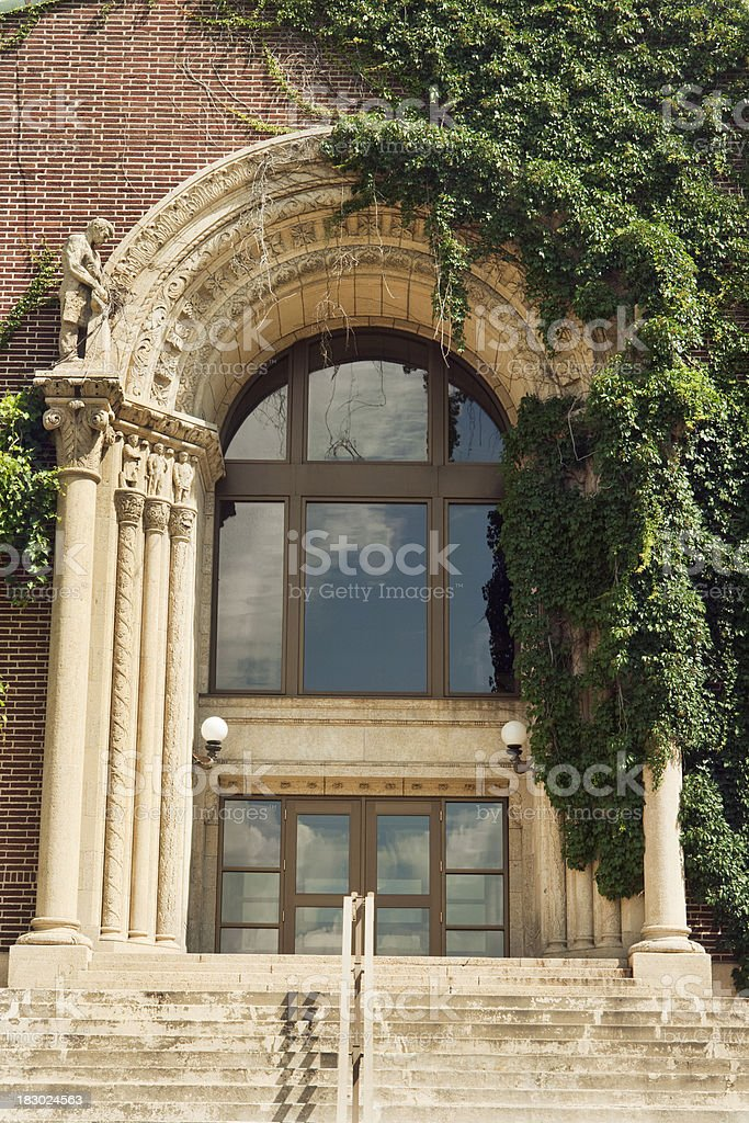 Higher Education College Stone Carved, Ivy Covered Front Door, Steps royalty-free stock photo